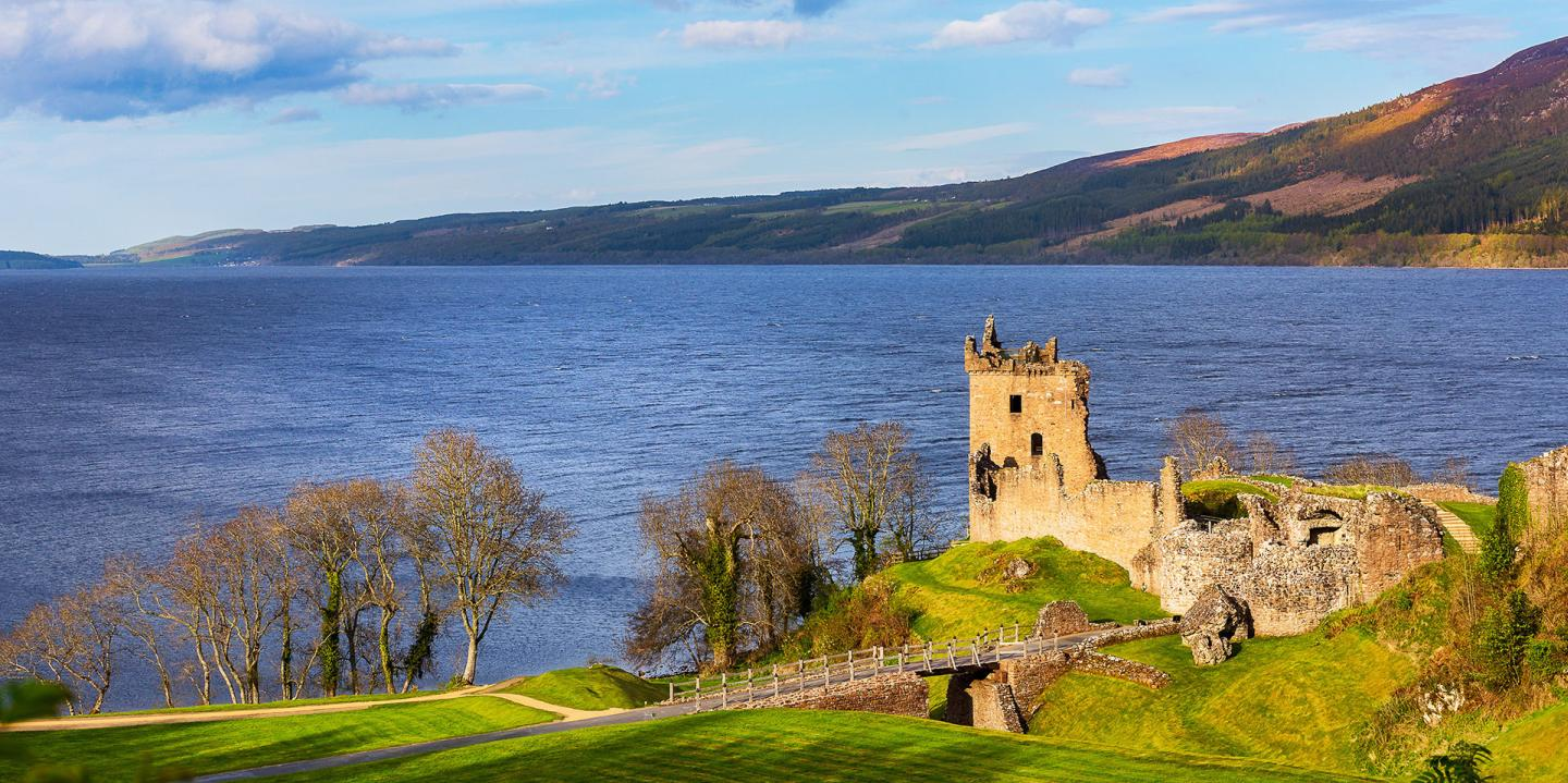 Urquhart Castle With Loch Ness In The Background